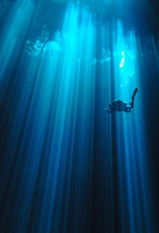 The Pit Cenote Light and Diver